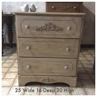 Solid wood dresser/nightstand with lovely appliqués and matching knobs. All drawers work perfectly   London, N5Y 5G3