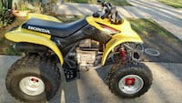 yellow and black Honda ATV 2390 mi