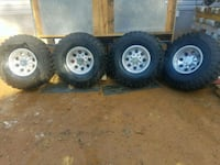 four silver bullet hole wheel and tire 106 mi