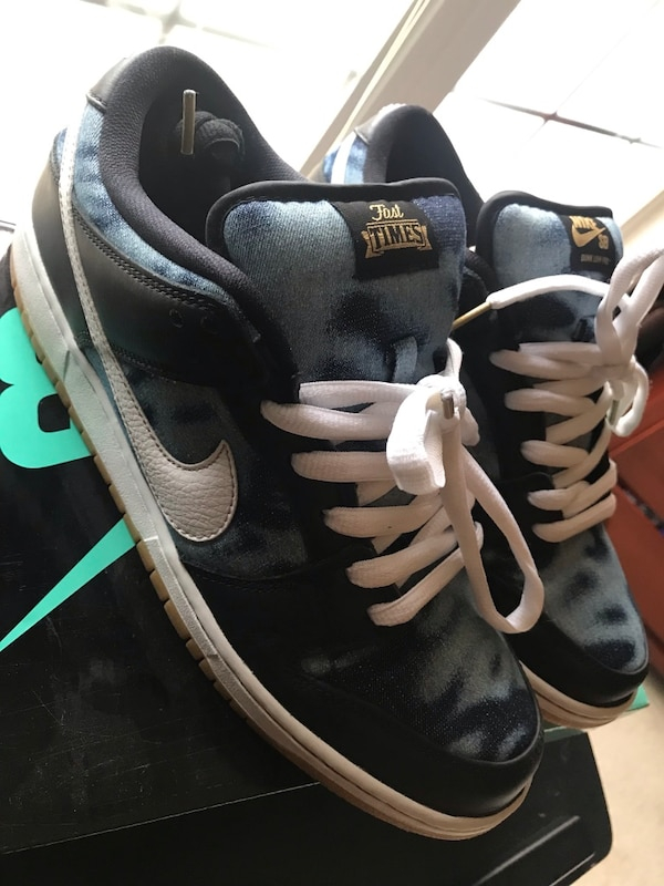 pair of black-and-white Nike sneakers