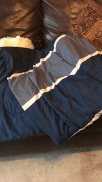 two matching twin size comforters and dust ruffles
