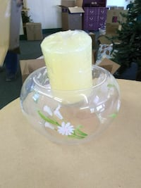 clear glass candle holder with beige pillar candle \