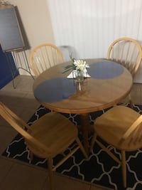 Table and chairs. Good condition looks like new.. has a glass to cover wood. Make me an offer Merced, 95341