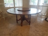 65 inch like new wood table with matching lazy susan