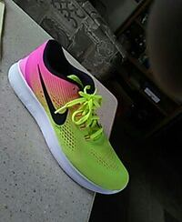 unpaired green, pink, and white Nike sneaker Shelton, 98584