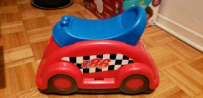 Small red ride on toy