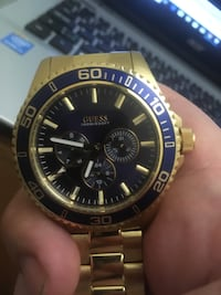round gold-colored chronograph watch with link bracelet Edmonton, T5Y 6A8