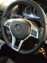 black and gray car steering wheel 1 km