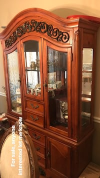 brown wooden framed glass display cabinet 14 mi