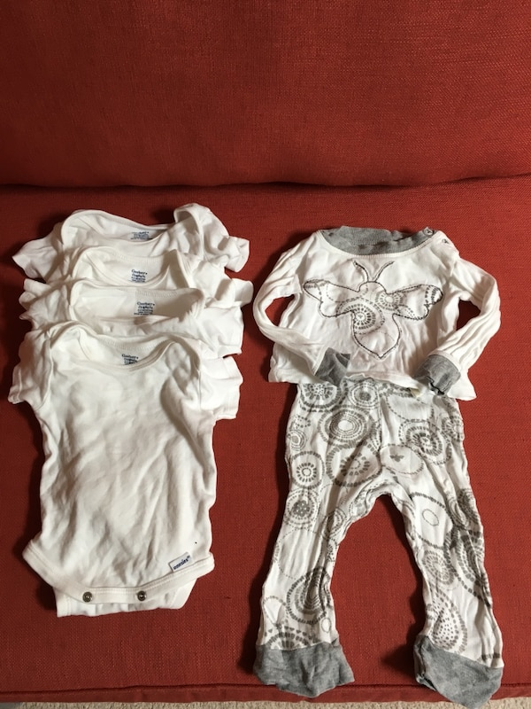 4 onesies - 0-3 month size - and a newborn top and pants