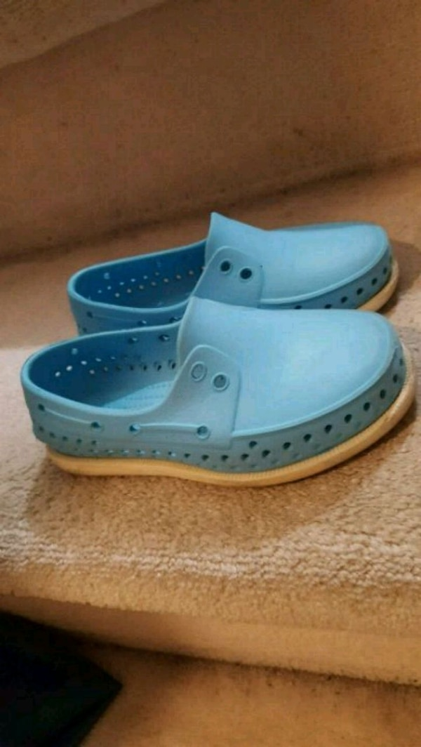 pair of blue Crocs rubber clogs