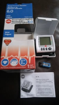 white and black digital blood pressure monitor with box Beaumont