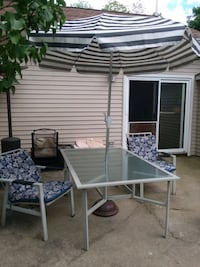 8 piece patio set- table-6chairs(2) rocker- umbella-2 chair cushions.