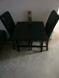 rectangular black wooden table with four chairs dining set Falls Church, 22044
