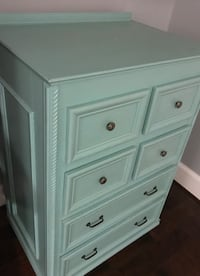 white wooden 4-drawer chest