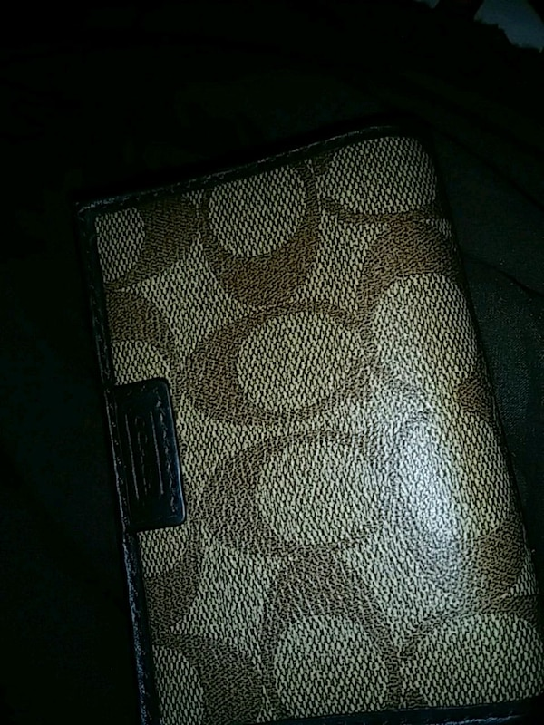 black and gray monogrammed Michael Kors leather wallet