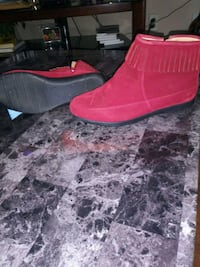 pair of red suede slip-on shoes