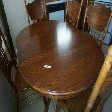oval brown wooden dining set