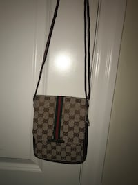 Gucci Brown and black monogrammed gucci leather crossbody bag King City