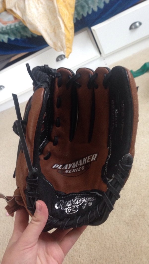 Brown and black playmaker series leather baseball mitt