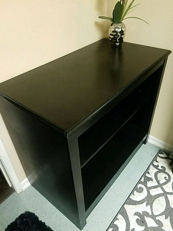 Tv stand , solid black wood. no scratches,  cracks 3