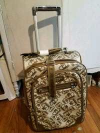 brown and white floral luggage Hampton, 23666