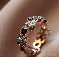 Red apple ring with stunning colorful diamonds. Not used  TORONTO