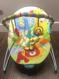 baby's white, green, and brown animal printed bouncer seat