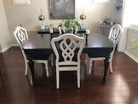Solid wood black table with spindle legs. 4 white chairs with black seats Carlsbad, 92011