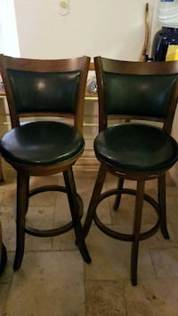 two black leather padded chairs 2283 mi