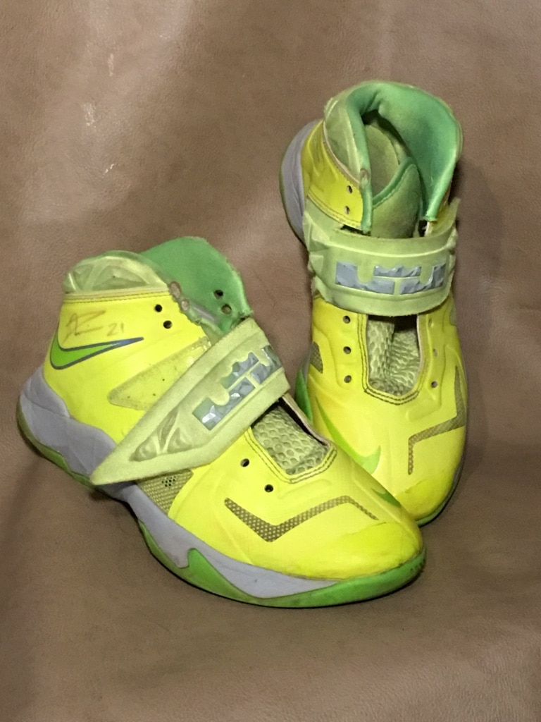 Pair of size 4.5 neon yellow Nike high top sneakers