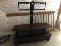Black wooden tv stand with mount. Glass shelf, and own drawer. Light wear..  Leesburg, 20175