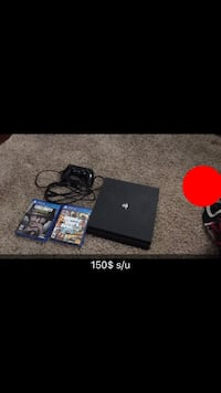 black Sony PS4 console with controller and game cases null