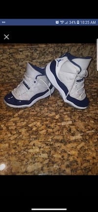 pair of white-and-blue Nike basketball shoes 2318 mi