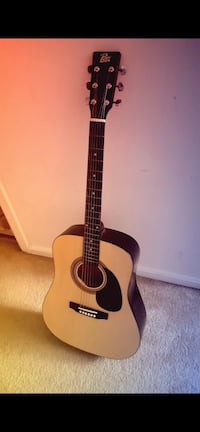 Acoustic guitar (Rogue) with case  NO POTOMAC, 20878