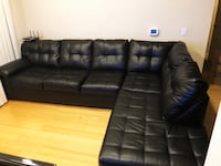 Black leather tufted sectional sofa San Diego, 92101