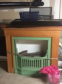 brown wooden framed electric fireplace Surrey