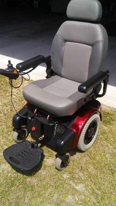 gray, black and red powered wheelchair