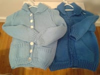 two blue and teal knitted button-up sweaters