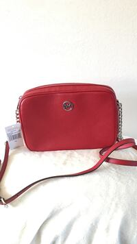 Red mk leather sling bag