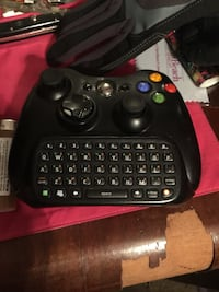 Black xbox game controller and key board