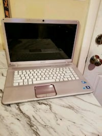 gray and black HP laptop 77 km