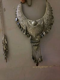 silver-colored necklace with pendant 1964 km