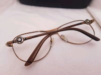 black and brown framed Versace eyeglasses 1695 mi