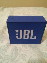 blue and white JBL wireless Bluetooth speaker