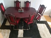 Solid Cherry wood handcraft dinner table with 6 chairs on great condit