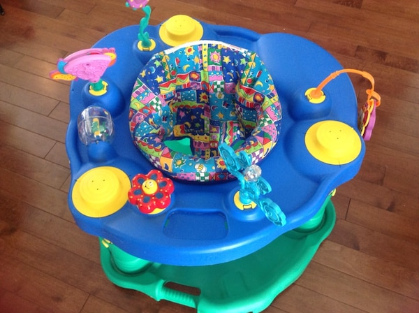 baby's blue and green activity saucer