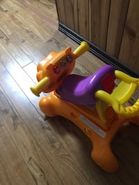 toddler's yellow and red ride on toy Cambridge, N1T 1P7