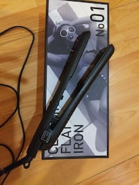 black corded hair flat  iron with box