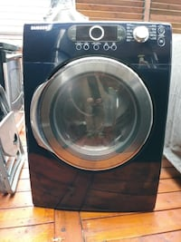 black and gray Samsung front-load clothes washer Laval